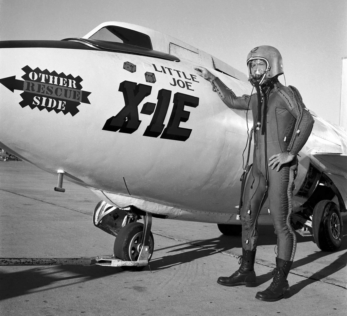 What an anwesome photo!  NASA test pilot Joe Walker in pressure suit with X-1E. 27 January 1958.