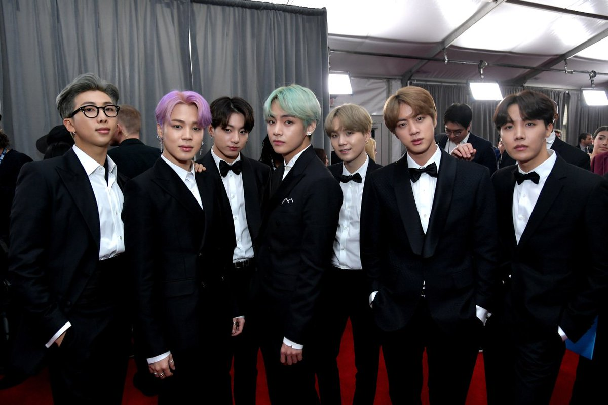 .@BTS_twt looking sharp as hell on the #GRAMMYs red carpet 😎