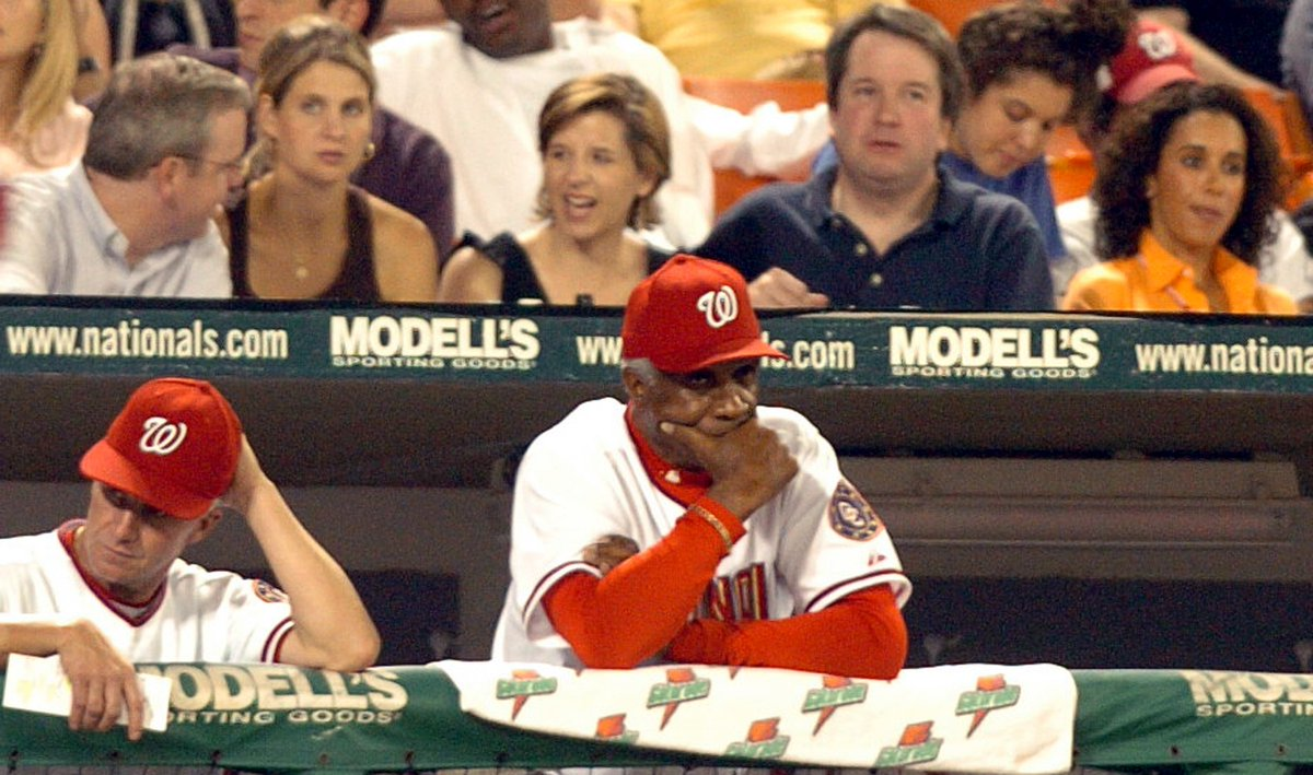 Looking at old pictures of Frank Robinson on Getty, I came across this one. Guy in the blue polo looks familiar.