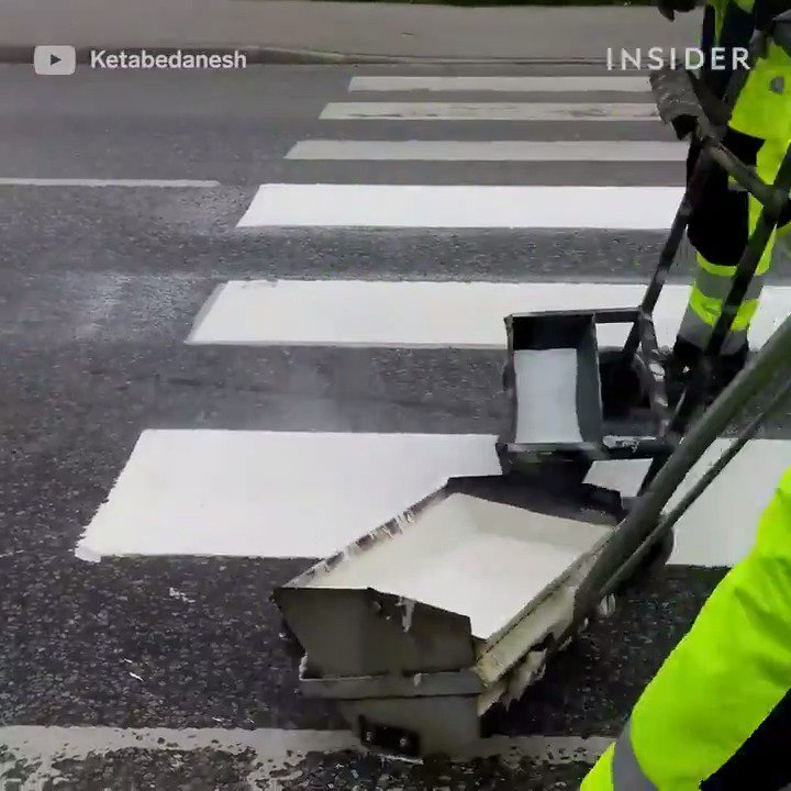 Road workers have to be precise when painting road signs 🖌