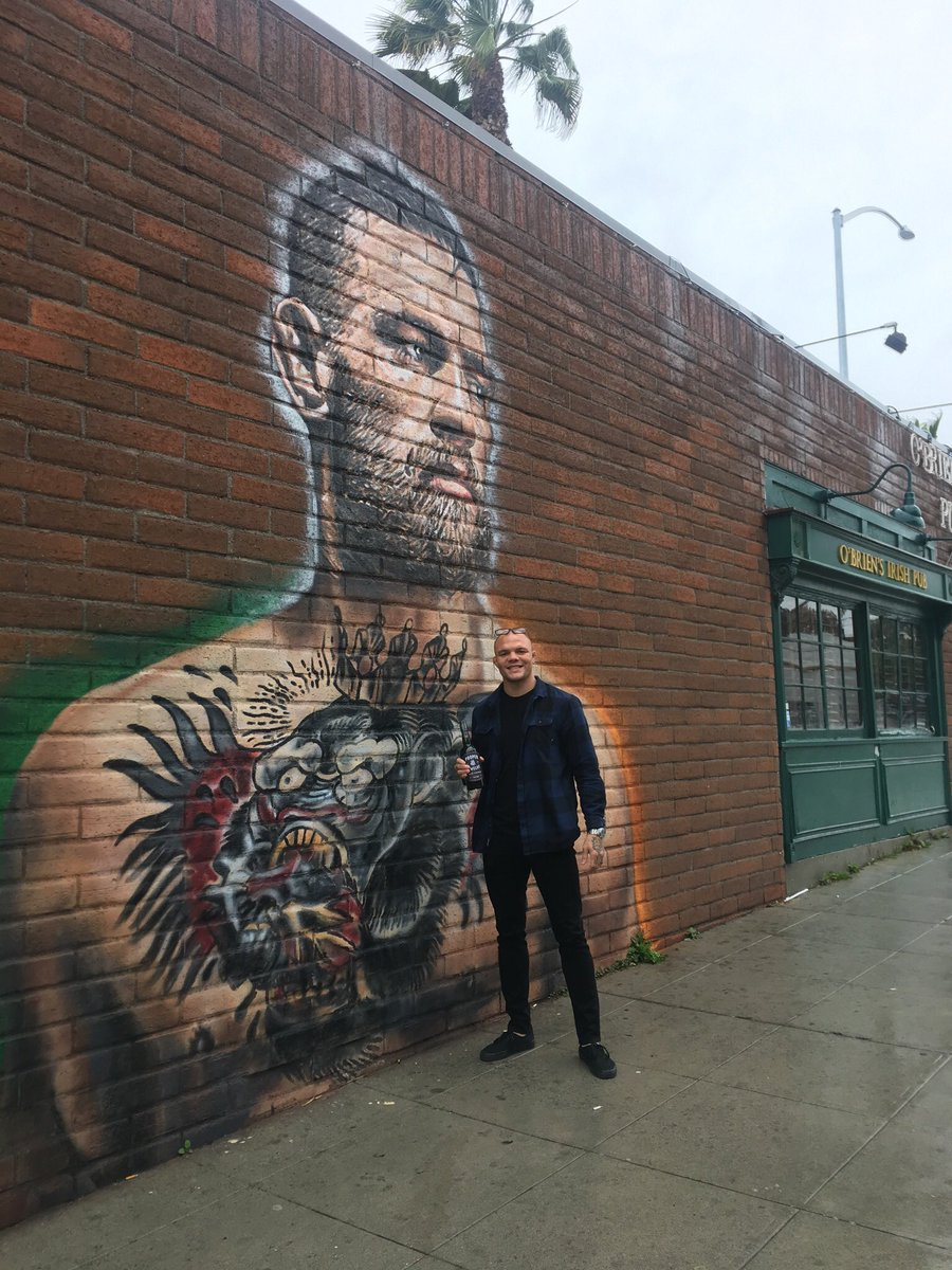 @lionheartasmith Saw the mural of @TheNotoriousMMA and  came in to O'Brien's to get a shot of @ProperWhiskey I gave him a whole bottle! Such a nice guy, Good luck in UFC 235, Anthony! #UFC235