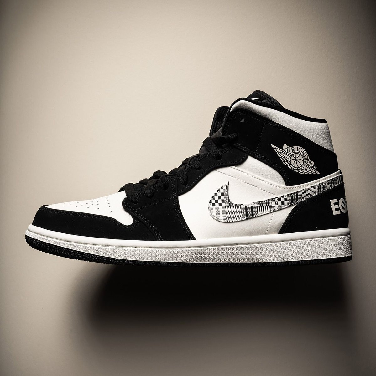 "61eed0539 ... Jordan 1 Mid ""Equality"" celebrates African-American heritage with bold  African-inspired graphics and ""EQUALITY"" printed on each heel to promote an  equal ..."