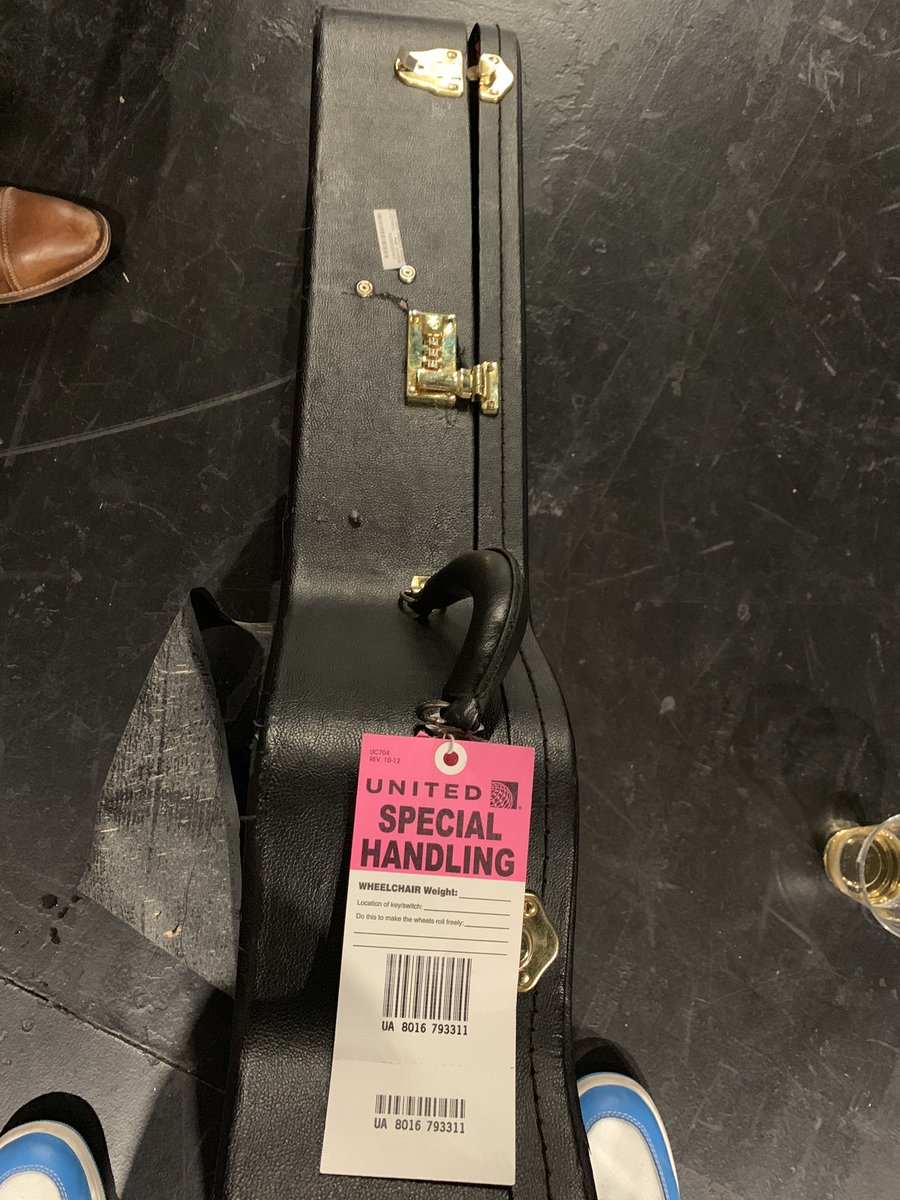 They gave me the handle with care tag  when I gate checked my acoustic but some how the case holding my $10k guitar still looks likes this.   @united