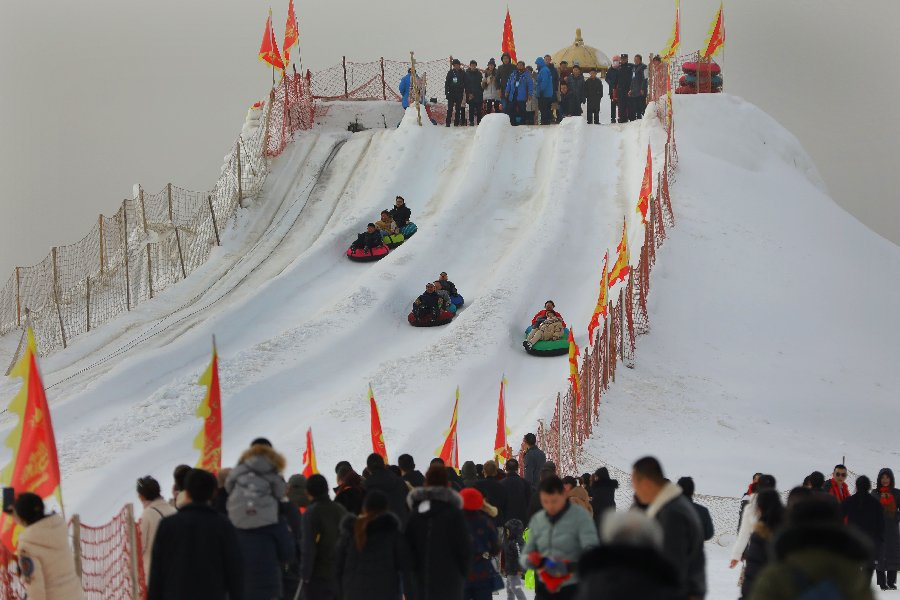Spring Festival on ice! People enjoy #ChineseNewYear on horse-drawn sleds and snow slides in Xinjiang, NW China
