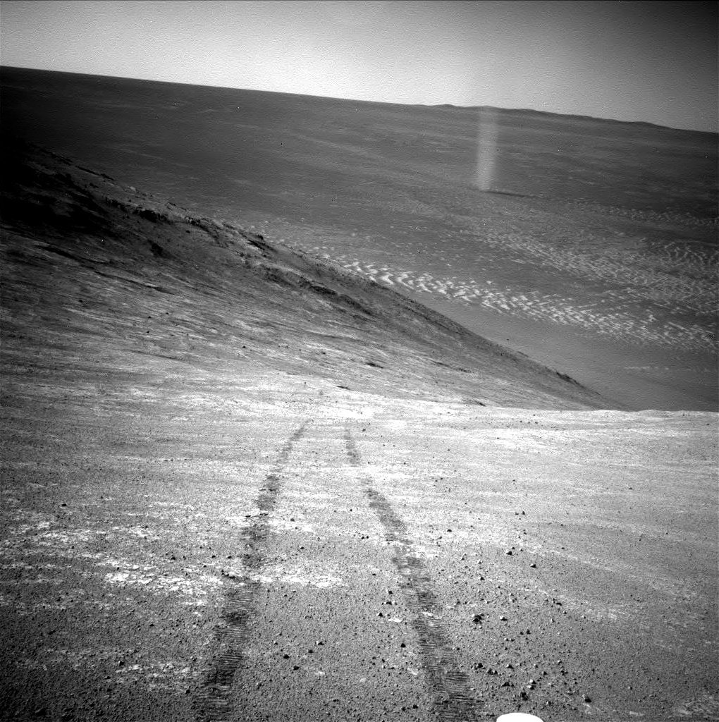 Opportunity trekked more than a marathon's distance and set the off-world driving record, spotting dust devils along the way. https://go.nasa.gov/2E805wR   #ThanksOppy