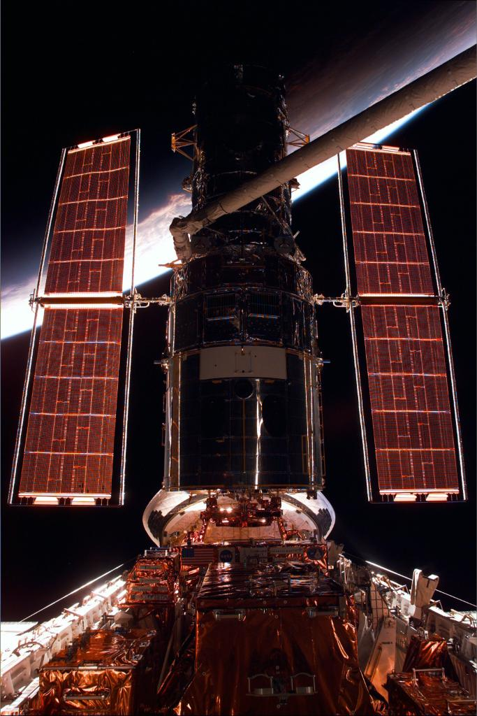 #OTD in 1997, astronaut Steve Hawley, who deployed Hubble using the space shuttle's robotic arm in 1990, used the shuttle's arm to capture Hubble from orbit in preparation for its second servicing mission.  #HubbleClassic