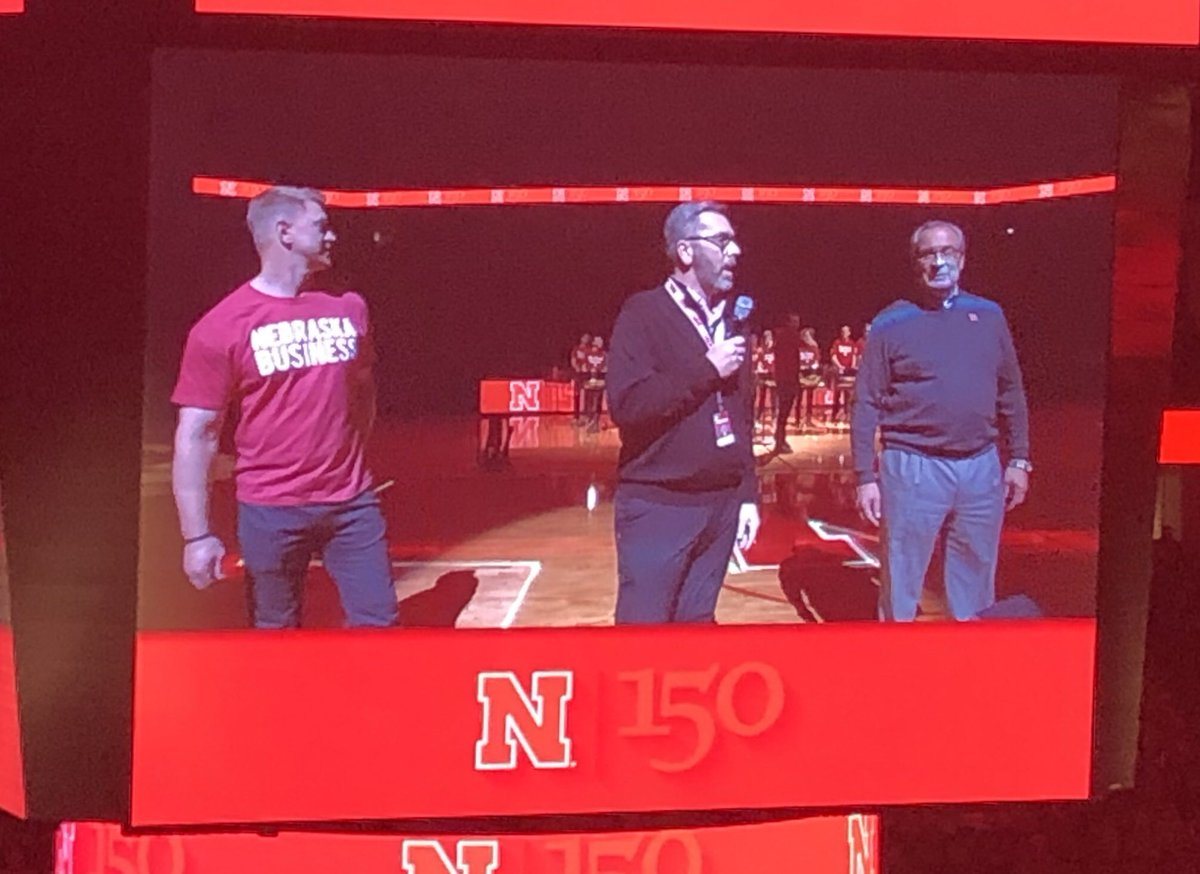 One of those three guys celebrating our 150th at half time is wearing a Nebraska Business T-Shirt.