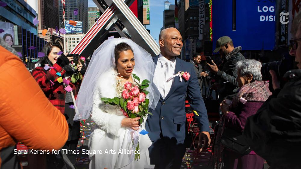 """Valentine's day just got a lot more romantic for the couples who said """"I do"""" and """"Yes!"""" to surprise a proposal in Times Square today. https://nyti.ms/2EaydIE"""