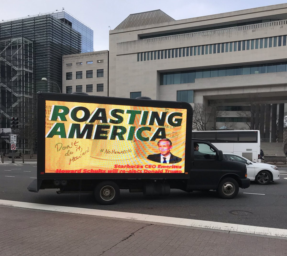 """Spotted by Capitol Hill: A truck with a """"ROASTING AMERICA,"""" anti-Howard Schultz digital billboard.   (Also blaring """"You're so vain"""" by Carly Simon.)"""