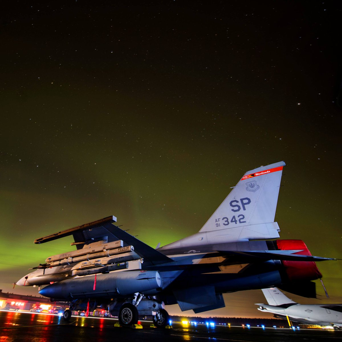 An F-16 Fighting Falcon assigned to the 480th Expeditionary Fighter Squadron sits on the flight line under the Aurora Borealis at Kallax Air Base, Sweden. . . . #F16 #Falcon #Viper #Pilot #USA #F16Viper #AirForce #USAF #AviationEnthusiast #Military #PilotLife #MilitaryMachine
