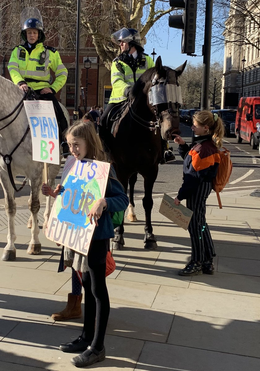 I do like a protest where the protesters politely ask if they can pet the police horses.