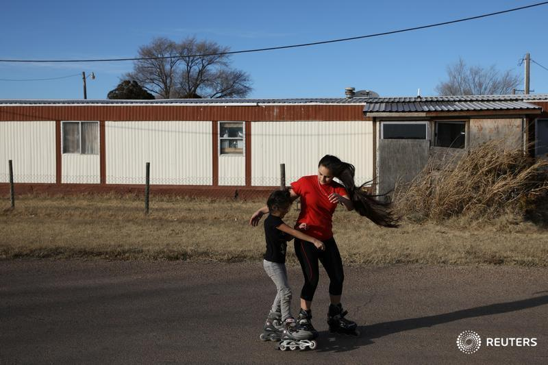 The mobile home that Orfa and her three children share in Texico, New Mexico, is hardly luxurious, but the town provides them with something they did not have in Honduras — safety https://reut.rs/2TRqioW  📷 @Lelliottphoto (1/8)