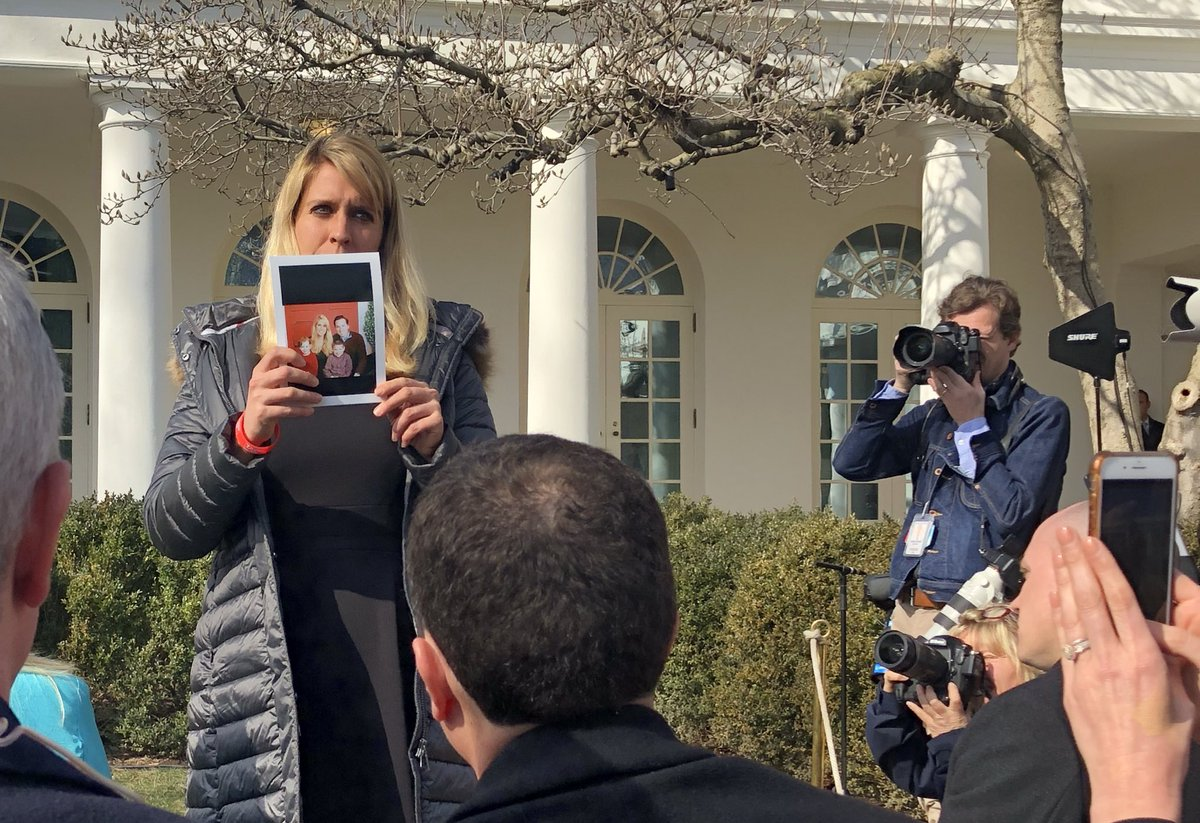 President Trump has had two women whose loved ones were killed by undocumented immigrants stand up and show photos of their late family members. Here's one woman who just stood up to show a photo of her husband.