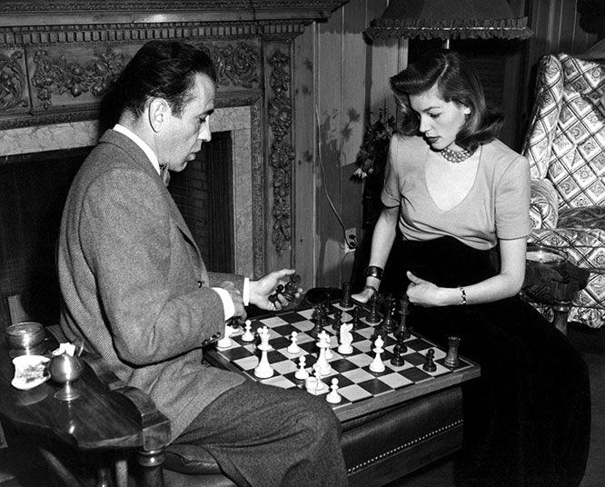 Humphrey Bogart and Lauren Bacall playing chess at home. #FridayFeeling #FlashbackFriday