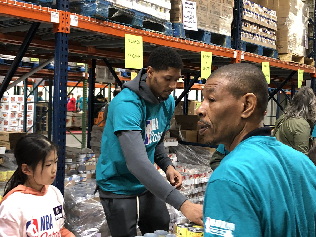 Bradley Beal and Charlotte Hornets legend Mugsy Bogues at the NBA All-Star Day of Service