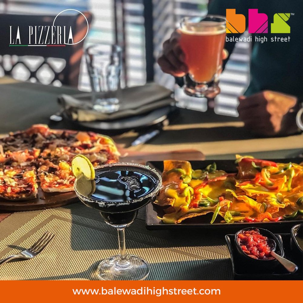 You'll want to scrape the plate clean after! Pictured is our : • Signature Nachos • Pizza Alla Vodka • Black Mamba Margherita. • Apple Cider 🍸 What would you dig into first? #lapizzeriaindia #cocktails #happyhour #balewadihighstreet #pune #punefoodies #LaPizzeria #BHS #pune