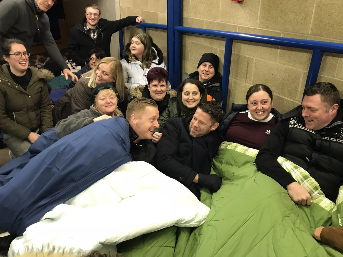 📸 @GarryMonk gets cosy with First Team Coach @1jamesbeattie as the pair share a laugh with Geoff.  Over £15,000 has been raised for the @Geoff_Hors_Foun so far through the Sleepout. 👏  #BCFC