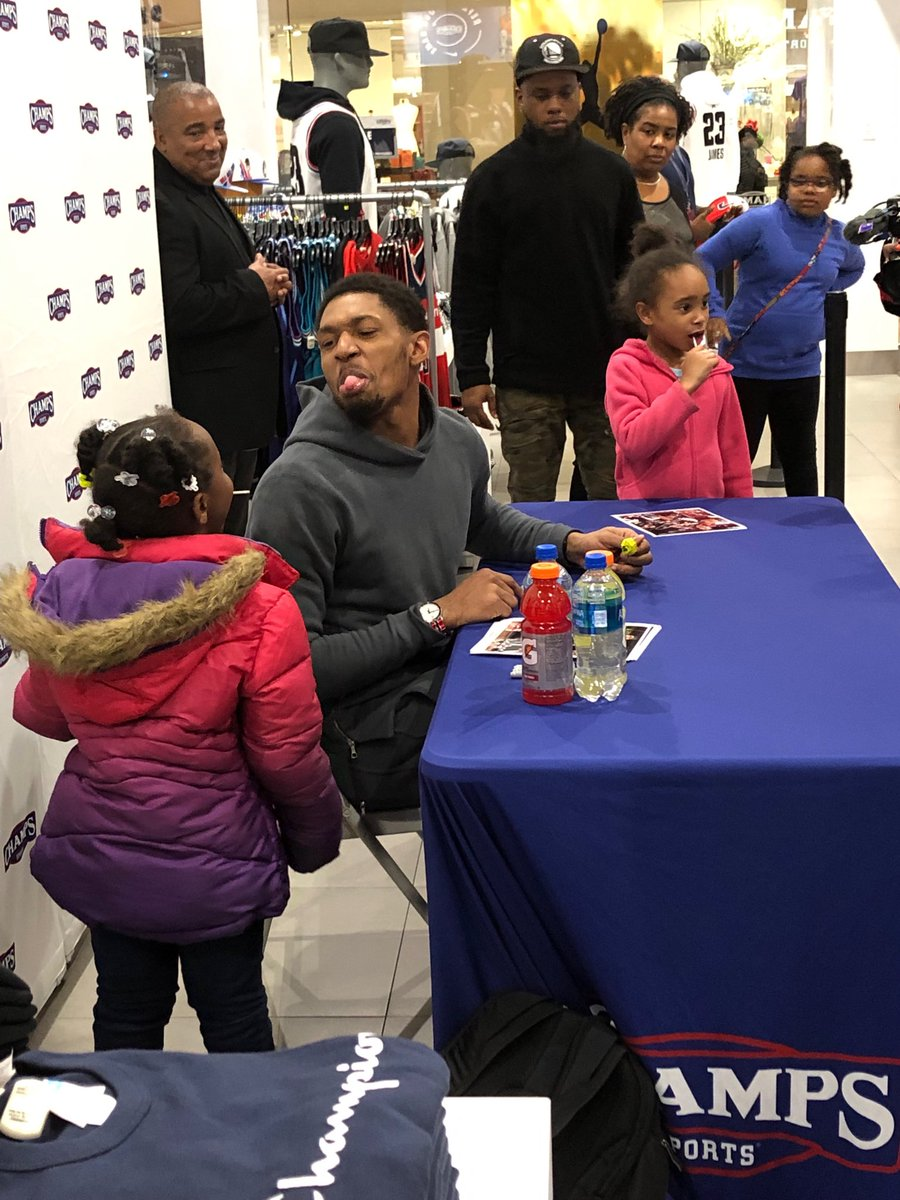 Bradley Beal takes a pic with three adorable girls with lollipops. He asks for a sucker and gets rebuffed by the cutie, the one with her back to the camera. But another girl passes him one and ...Beal celebrates this victory by sticking his tongue out.