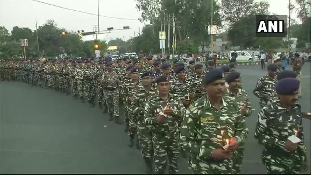 Madhya Pradesh: #CRPF officers and their family members hold a candle march in Bhopal to pay tribute to the soldiers who lost their lives in  #PulwamaAttack
