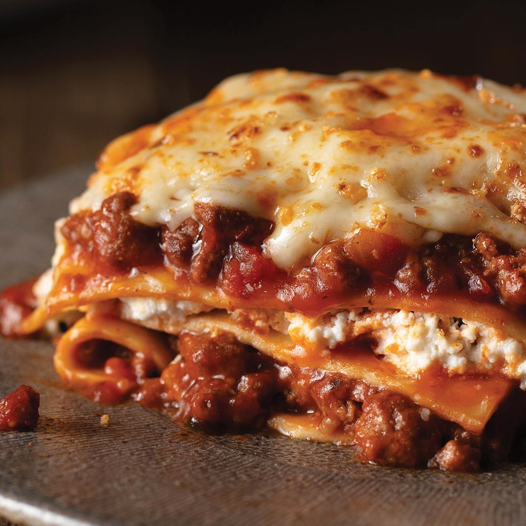 A traditional favorite that tastes homemade. Our lasagna is loaded with cooked ground beef, tomatoes, zesty seasonings, and 5 cheeses. Just heat and serve this delicious meal.   Shop our meals: http://bit.ly/2UTOS9B *Sold by OmahaSteaks. com, Inc.
