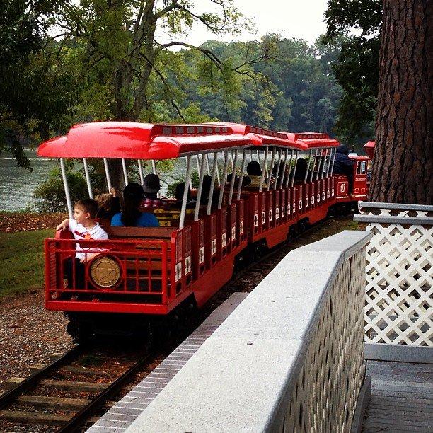 Don't miss the train!  (photo: @allyson1219) #repost #train #redtrain #highpointtrain #familytime #parkwiththefamily #highpoint #highpointnc #highpointcitylakepark #park #highpointpark #citylakepark  #highpointpool #ncparks #jamestownnc #nctourism  #visthighpoint