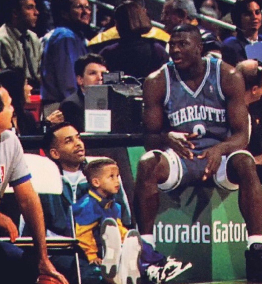 1992 All-Star Weekend: Steph Curry on his dad Dell's lap, as Larry Johnson looks on.