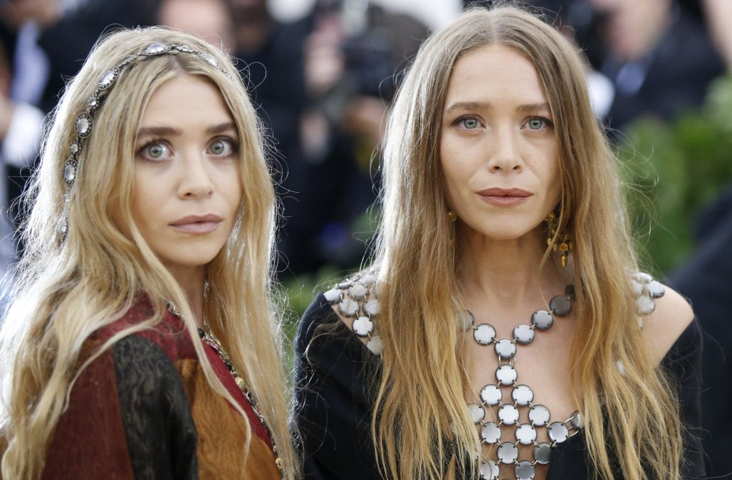 The Olsen twins look like one of them knows how you die and the other knows when you die.