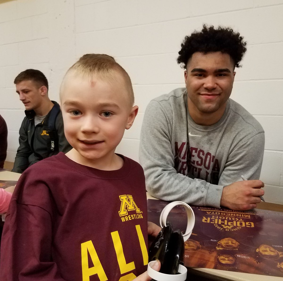 #Ollie with his favorite Gopher wrestler.  Thanks @GSteveson! #GopherTough