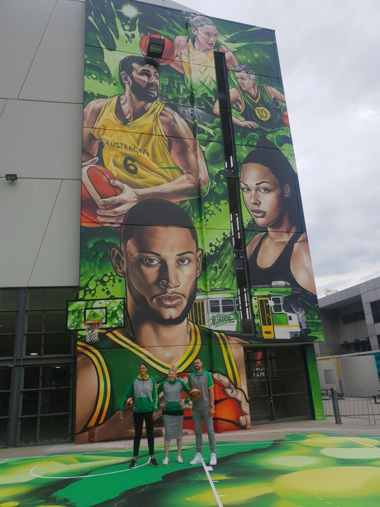 Icons of our games, @ecambage, @laurenej15 and @andrewbogut were on hand to check out the mural now up at @EtihadStadiumAU! #GoBoomers #GoOpals  #VisitVictoria