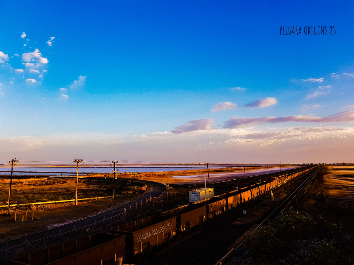 These train and tracks run across the Pilbara and bring iron ore to Port Hedland and taken to the Port, loaded on ships and taken to different locations across the world. #porthedland #pilbara #trains #traintracks #sunsets #cloud #YourShot #bhp #landscapephotography @NatGeoPhotos