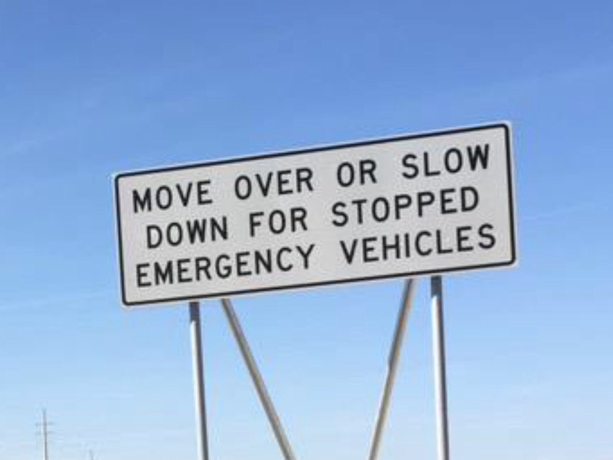 IT'S THE LAW IN NEVADA: Move over 1 lane or slow down for stopped emergency, service, utility or DOT vehicles on the highway. Doesn't matter what the color of the flashing lights are: RED, BLUE, AMBER or WHITE: SLOW DOWN & MOVE OVER!