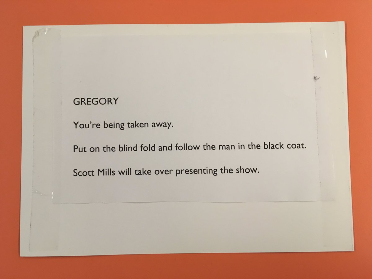 IT'S HAPPENING!  So @gregjames has been handed this note, blindfolded and removed from Radio 1 HQ by a mystery man in a black jacket. @scott_mills will be presenting until further notice...