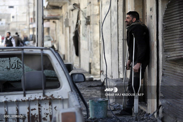 🇸🇾 A disabled Syrian man looks at the destroyed house of his neighbour in the rebel-held town of Maaret al-Numan in the north of Idlib province.  📸 @omar_hajkadour  #AFP