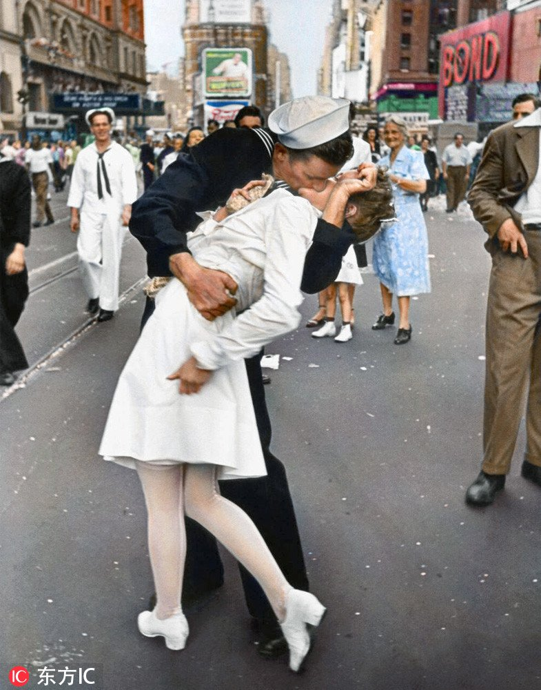 George Mendonsa, identified as the 'kissing sailor' in the iconic Times Square photo that came to symbolize the end of World War II, has died at 95.