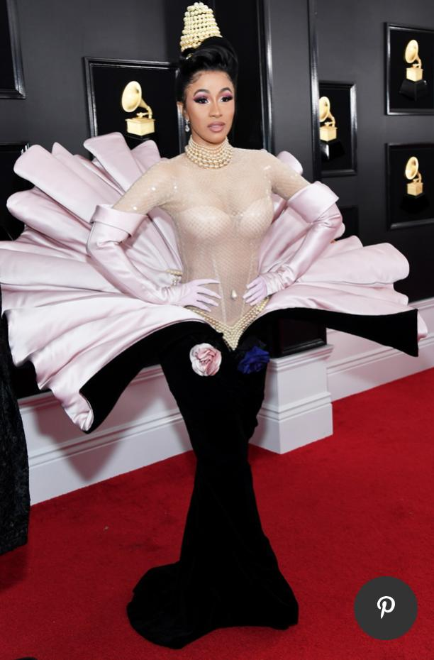 Attention everyone: Cardi B has arrived. Just in case you couldn&#39;t find her on the red carpet, here is what the rapper dressed to impress in. #Grammys2019 <br>http://pic.twitter.com/FjMwWPts1h