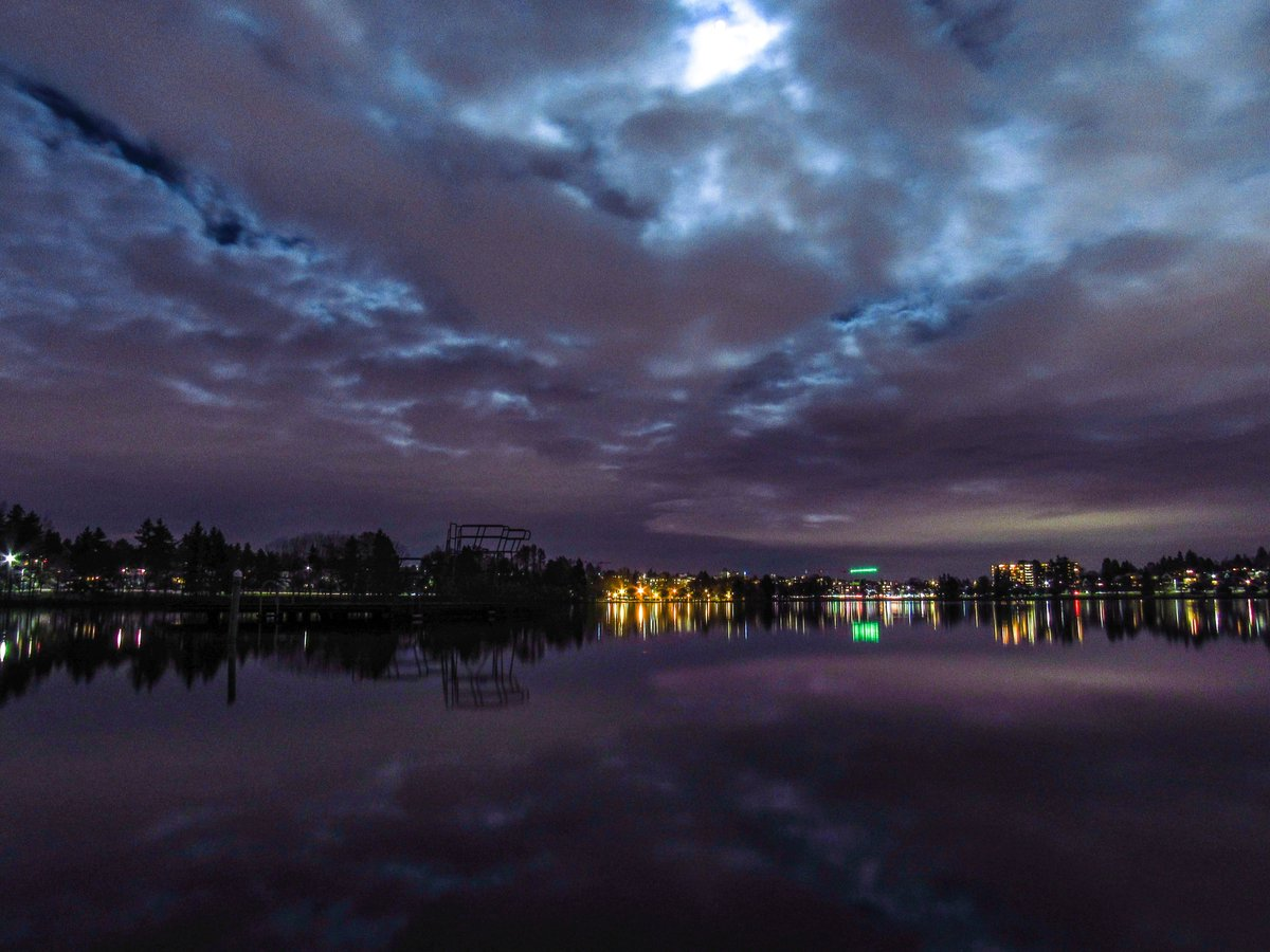 Clouds backlit by tonight's #Supermoon reflecting off the glassy water of Seattle's Green Lake this evening. #wawx