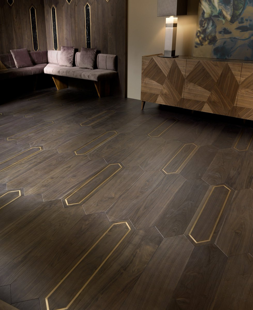 Matita | American Walnut Brass. The gorgeous Matita range this merging of wood with other materials is inspiring from a design perspective. Sustainability is critical to us and evermore so in 2019. #flooring #interiordesign #interiors http://urbaneliving.co.uk