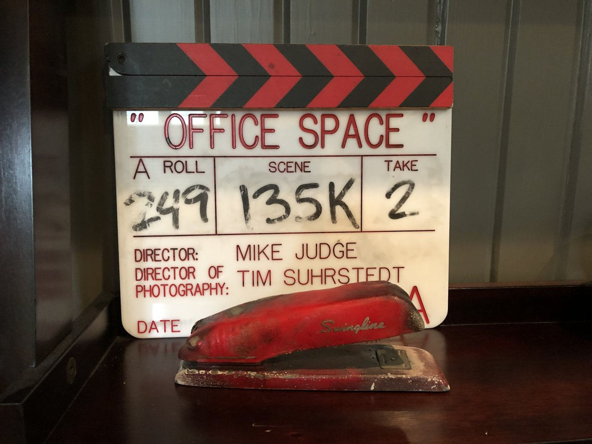 20 years ago today, Office Space came out in theaters. This is the clapper from the last scene we shot. As you can see, Stephen Root nailed it in two takes. And that's the actual stapler from the movie. (It got burned when Milton set the building on fire.)