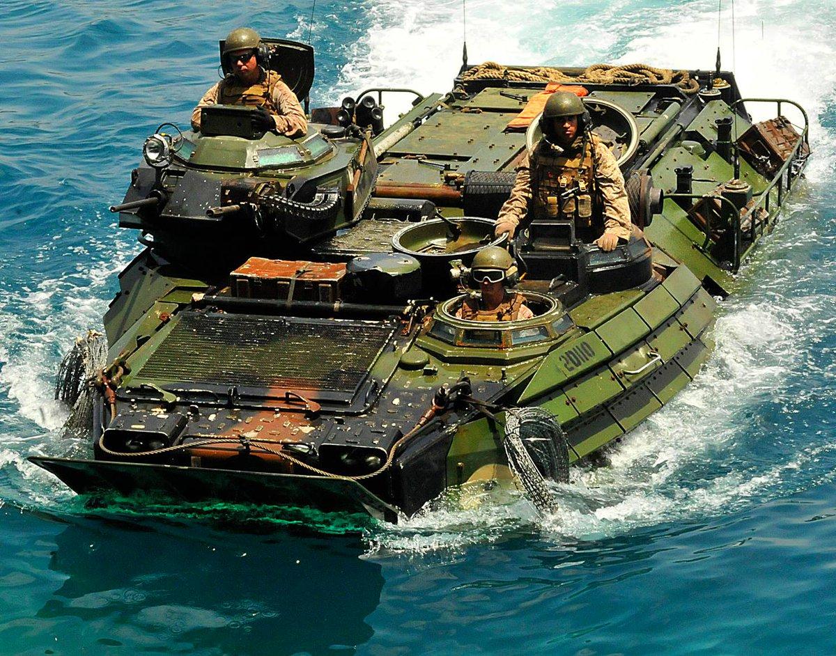 This U.S. Marine Corps amphibious assault vehicle, carrying Marines assigned to the 22nd Marine Expeditionary Unit, returns to the amphibious dock landing ship USS Whidbey Island.  #Marines #MarineCorps #AAV #Amphibious #USMC #MilitaryMachine