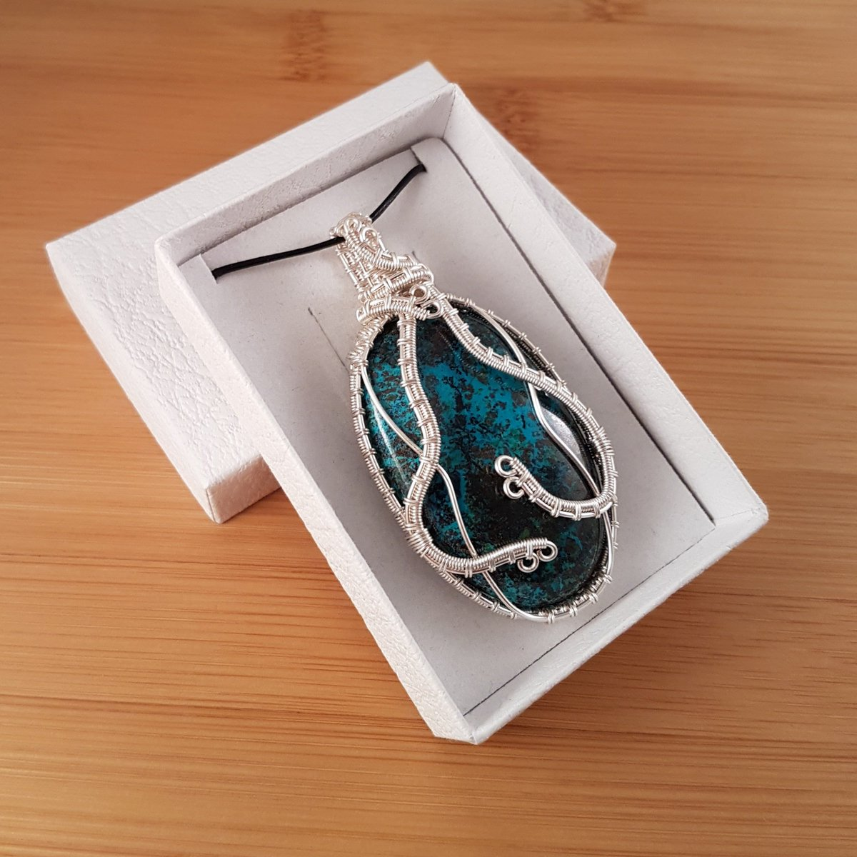 Blue oval pendant in white box