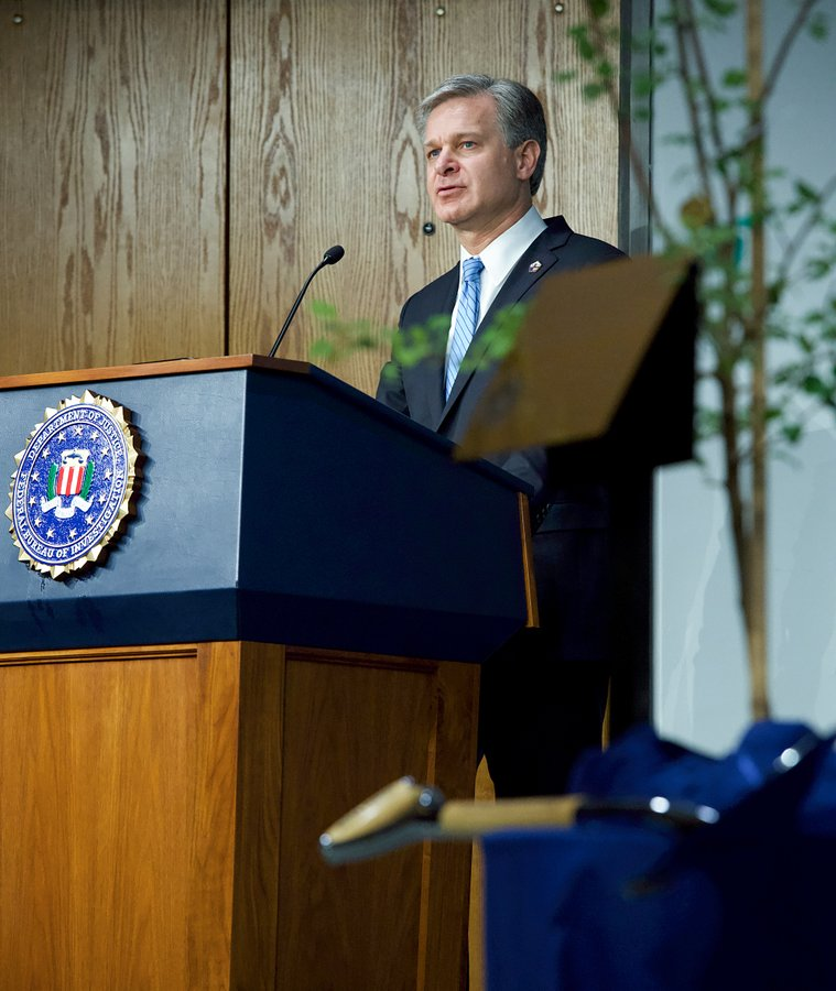 Director Christopher Wray speaks at a ceremony during which the FBI dedicated a seedling from the Survivor Tree to FBI personnel who died as a result of 9/11.
