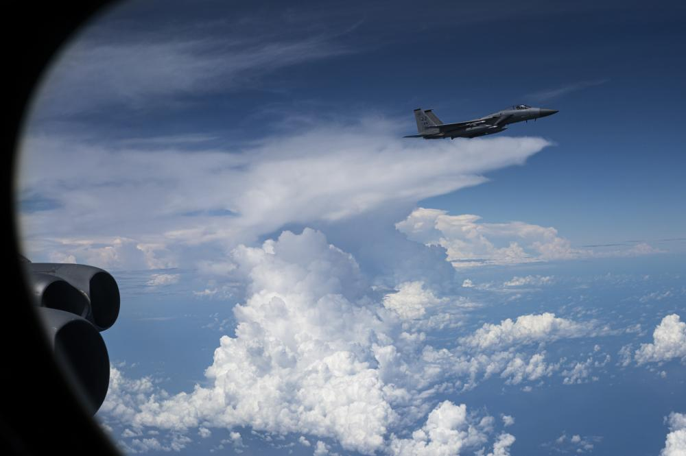 An F-15C Eagle assigned to the 67th Fighter Squadron, @KadenaAirBase improves bomber interoperability with #FriendsPartnersAllies during a Bomber Task Force mission over the #FreeandOpenIndoPacific.