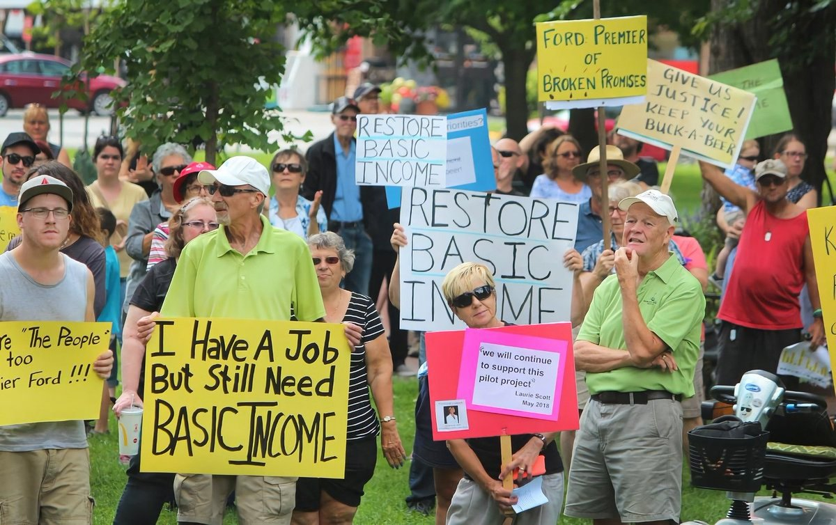 Thinking of printing this gentleman's basic income sign for the #BasicIncomeMarch this year. He's a legend. Thoughts?