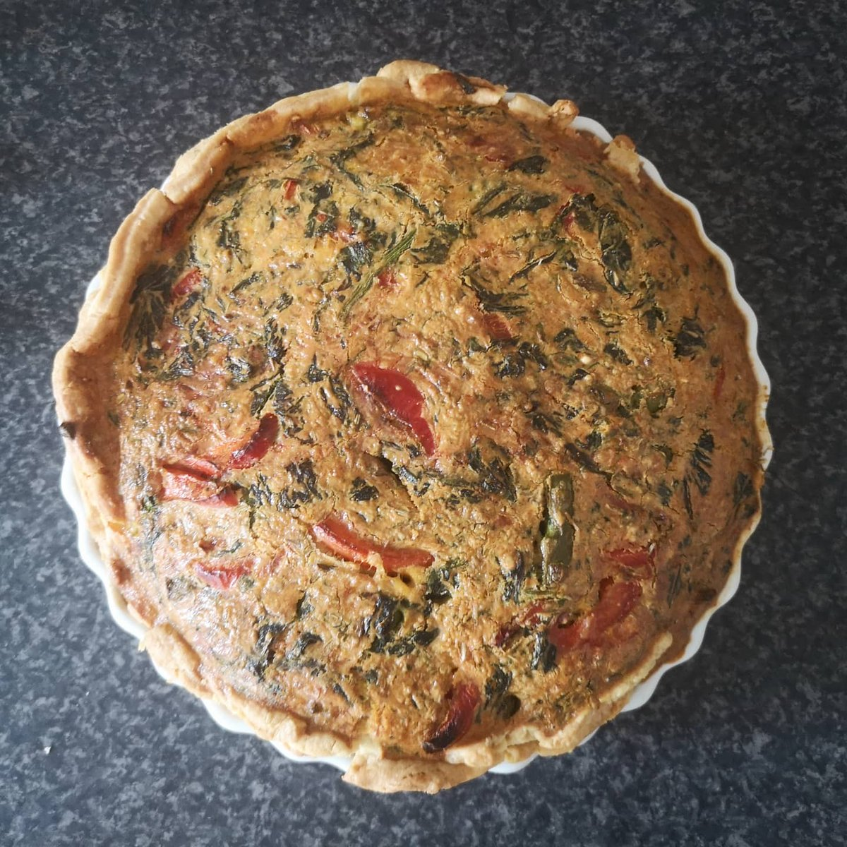 I made a quiche!  Asparagus, red pepper, spinach, paprika and cheese.  #cooking #food #quiche #vegitarian https://t.co/LinJ5v72fp