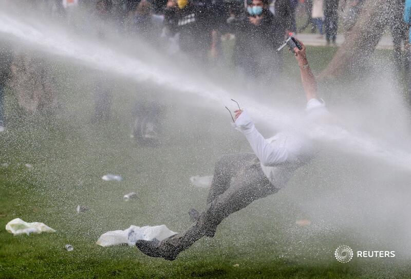 A man is hit by a water cannon during clashes with police as people gather at a park for a party called 'La Boum 2' in defiance of Belgium's coronavirus social distancing measures in Brussels. More photos of the week: https://t.co/yOyjH6QVNK 📷 Yves Herman https://t.co/WAkiJcJYAI