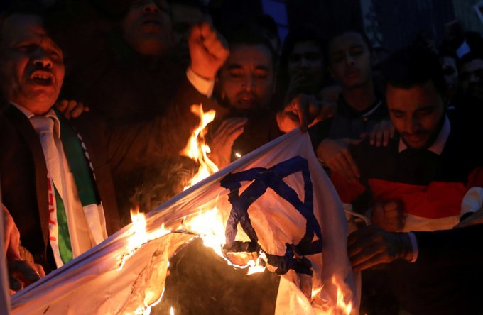 Iranian man ironically catches fire while burning an Israeli flag Photo