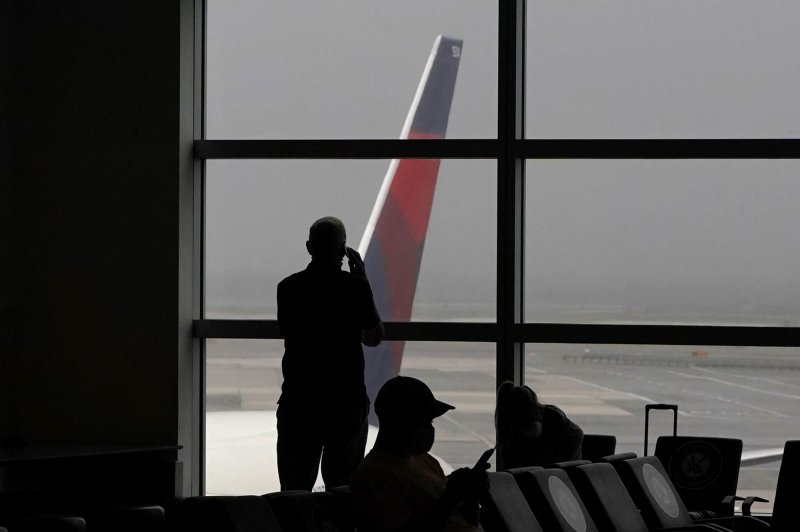US halts all travel from India due to severe COVID-19 surge Photo