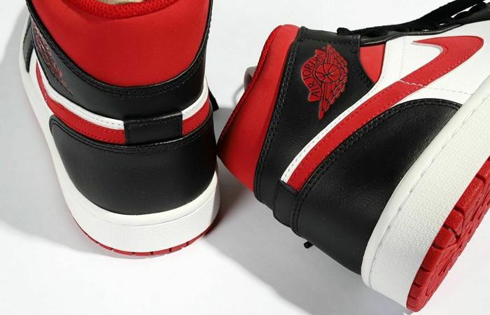 Select sizes carting Jordan 1 Mid 'White/Gym Red' =