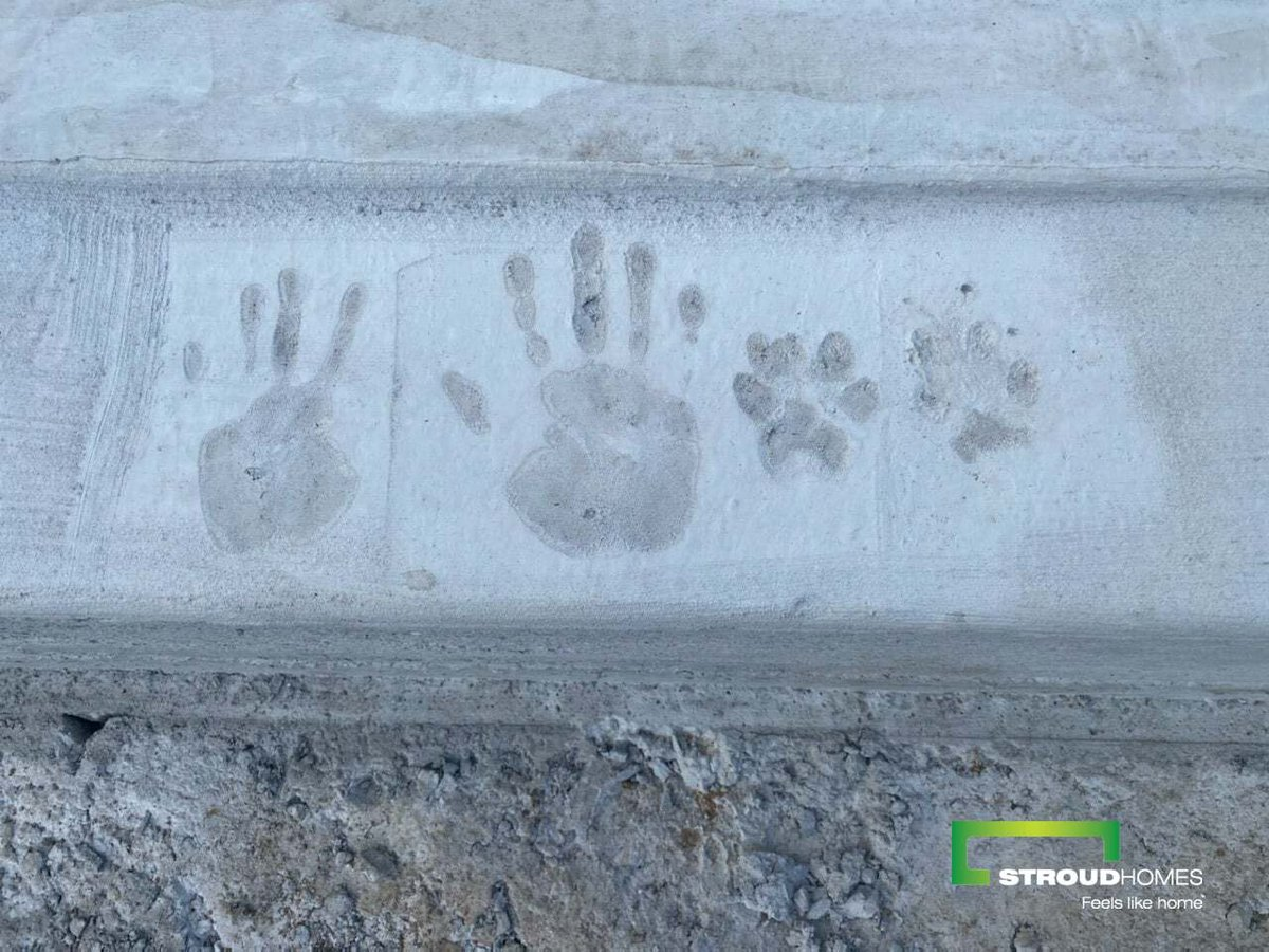 Some very excited clients marked their hand and paw prints on the concrete to celebrate the slab pour of their new Beechmont 220 Hamptons home. #stroudhomes #feelslikehome #beechmont220 #newhome #blackandwhitequotes #happy #lovedbyyou #slabday #handprintceremony #handprint #slab https://t.co/DLAnQ2ceIY