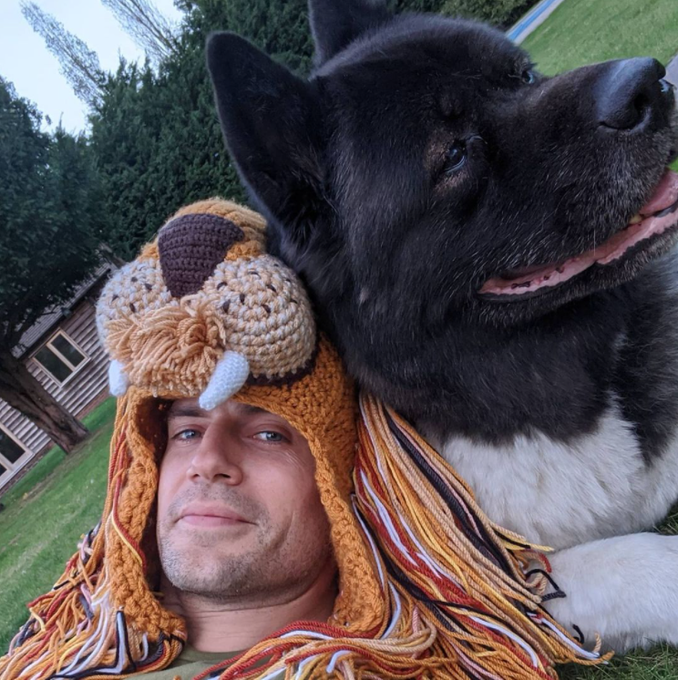 Happy birthday Henry Cavill. here he is with his dog Kal and a lion hat